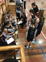 Darcy Rose coaching Rangi Ruru's Senior A women's basketball team.