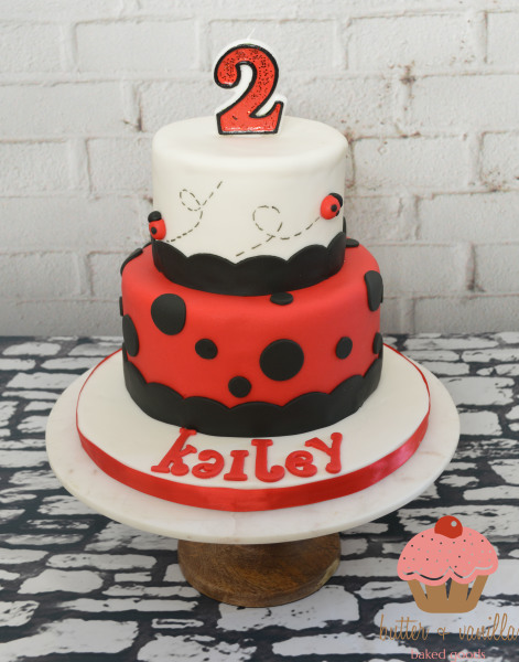 custom cake, butter + vanilla baked goods, calgary custom cakes, birthday cake, two tier cake, ladybug cake, red and white