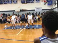 Youth Basketball player watching high school game