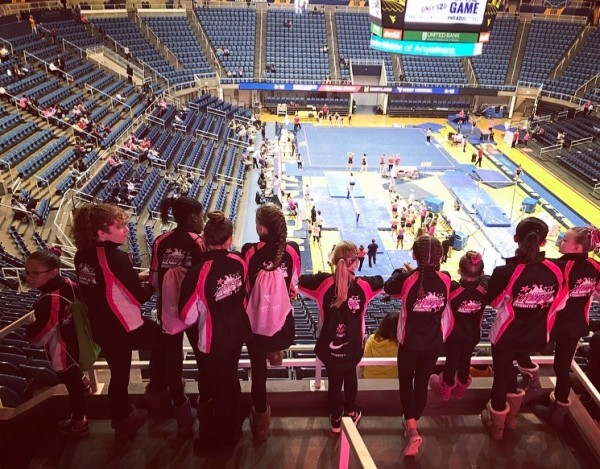Mountain Magic Girls support the WVU Gymnasts