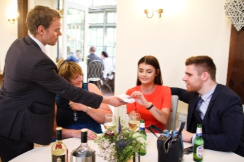 Danny Jewell Manchester Magician performs during drinks reception at wedding