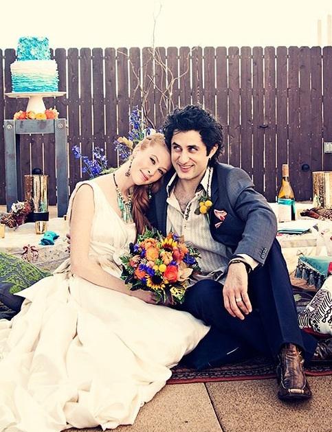 boho bride, aline skirt, one shoudler wedding gown, gpysy themed wedding, rehead bride, side bridal hair, braids, floor seating wedding