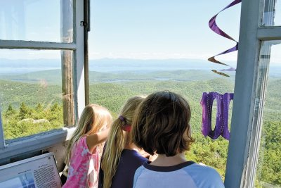 Three young girls take in the view of the Green Mountains and the Champlain Valley from the cab of t