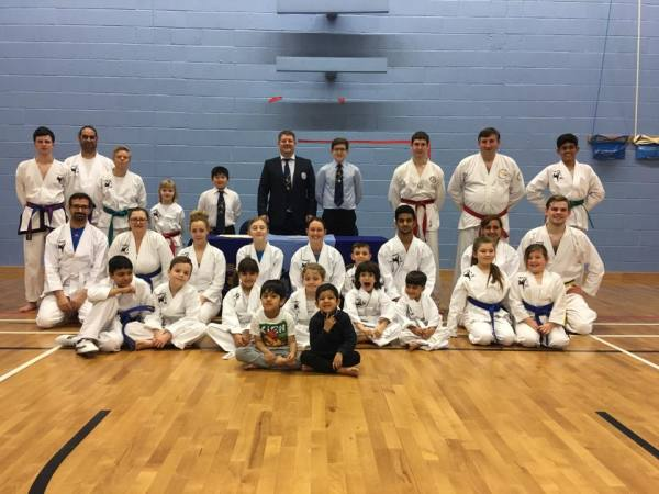 Grading group photo of students and instructor