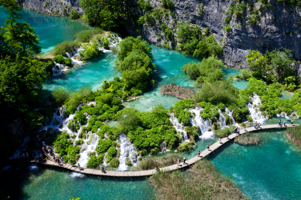 Walk the wooden boardwalks at Plitvice Lakes