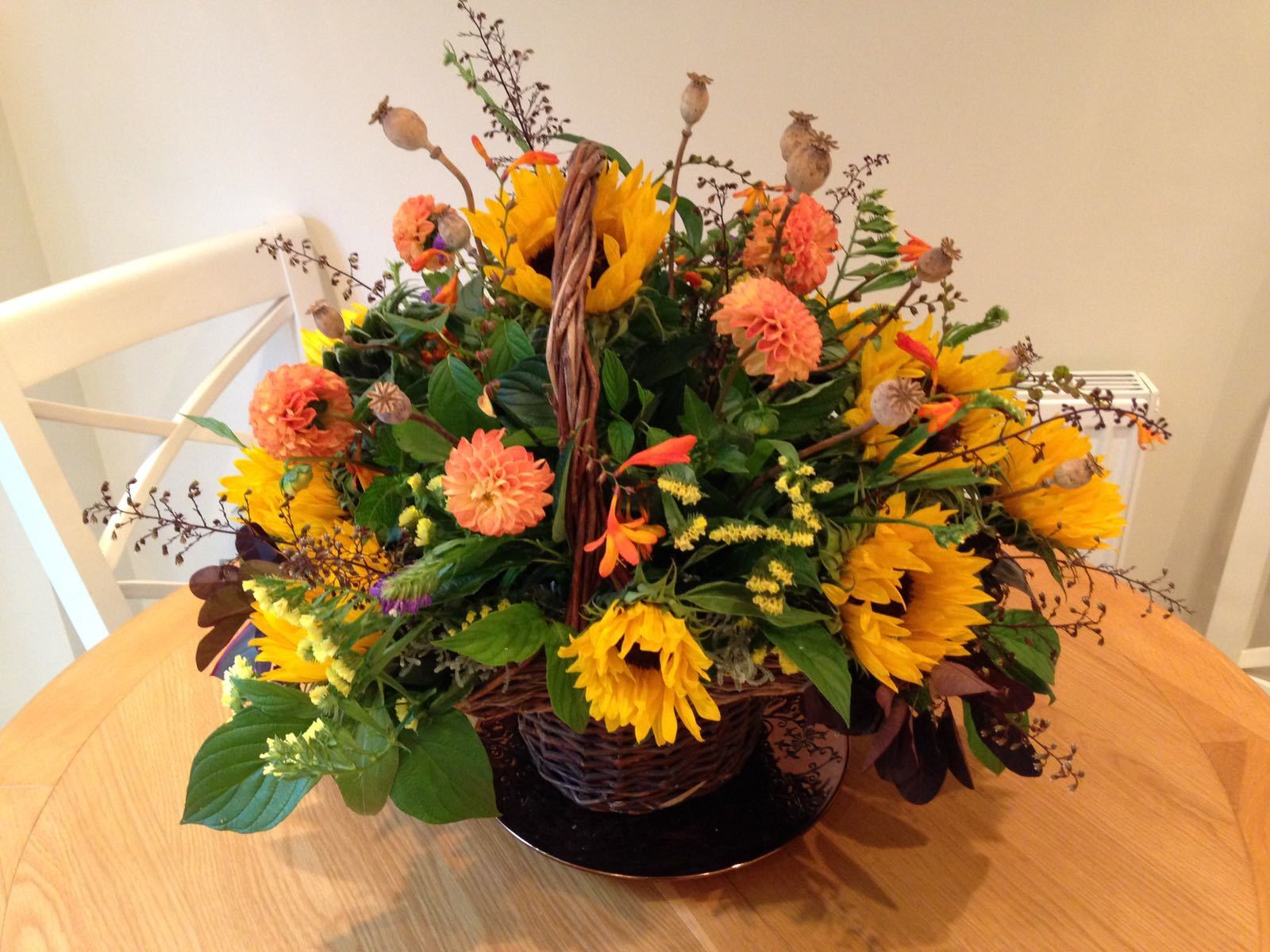 DISPLAY BASKET A wicker basket filled with your choice of flowers