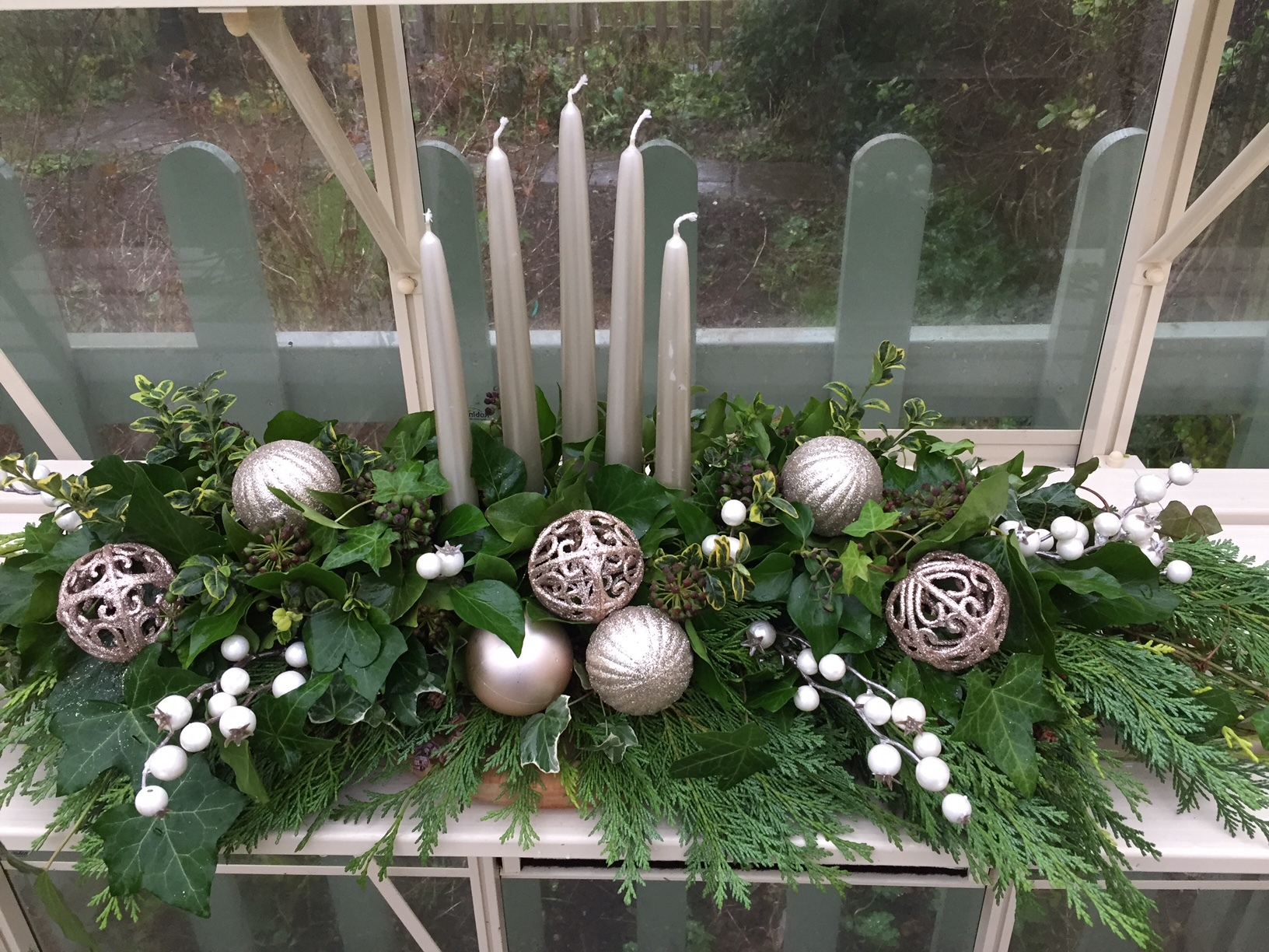 CHRISTMAS MANTLE DISPLAY A long and low with foliage