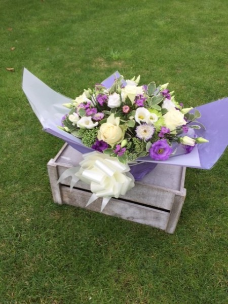 PURPLE BASKET DISPLAY A gift bouquet for any occasion
