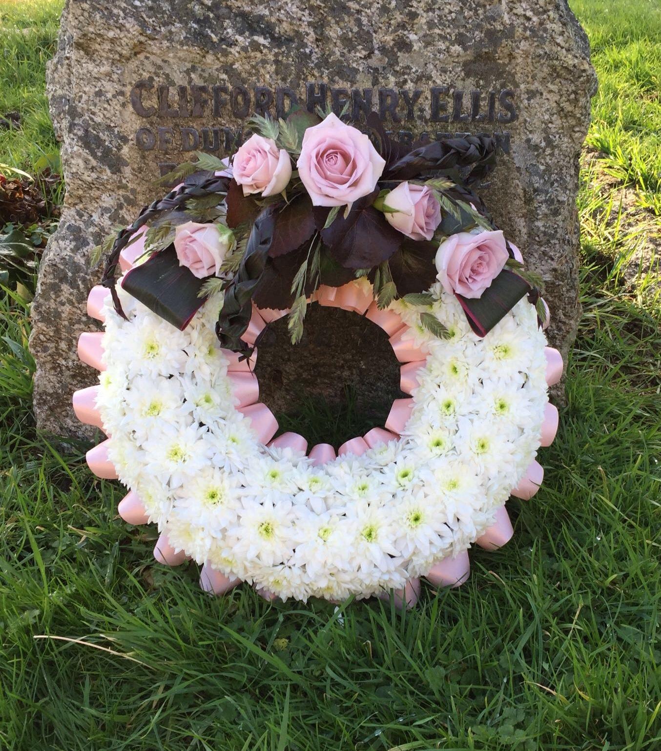 SYMPATHY RING WREATH Pink simple rose funeral display
