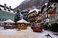 Traditional houses at the market square of Hallstatt in Upper Austria in Winter
