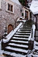 Stairs alongside traditional houses in Hallstatt in Upper Austria in Winter