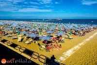 Bird view scene of the crowded beach of Lignano-Pineta, Italy, Europe