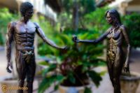 Adam and Eve sculptures in bronze in front of a outdoor shopping mall in Boca Raton, Florida, USA
