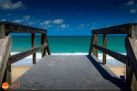 Wooden bridge leading to the sandy beach by the ocean in Vero Beach, Florida, USA