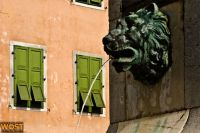 Bronze lion head on water fountain in historic downtown Cividale, Friuli, Italy