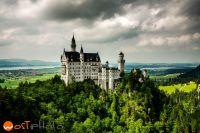 Historic castle Neuschwanstein with dark clouds