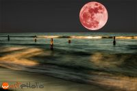 Composite of a full moon over the ocean at the beach in Boca Raton, Florida, USA
