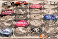 Composite of a collection of bottle caps