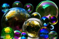 Composite of little and big colorful soap bubbles