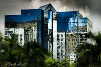 Bluish mirrored business building in Fort Lauderdale, Florida, USA reflecting another building