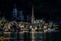 View from the lake at sunset onto Hallstatt in Upper Austria in Summer