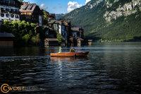 Boat in front of Hallstatt in Upper Austria in Summer seen from the lake
