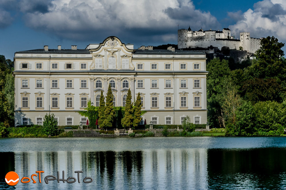 Leopoldskron at the pond with castle Hohensalzburg in the back in Salzburg, Austria