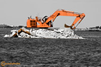 Construction excavator in the Intracostal in Lantana, Florida