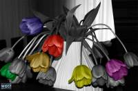 Composite of colored tulips in a vase with hanging heads