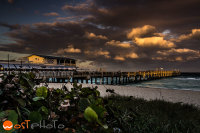 Lantana pier under cloudy sky and during sunset in Palm Beach, Florida, USA