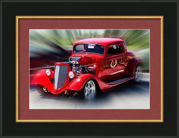 Red tuned retro car in frame with mat