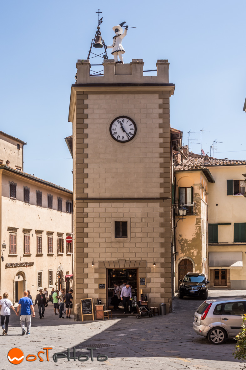 Pulcinella at the clock tower at the corso in Montepulciano, Tuscany