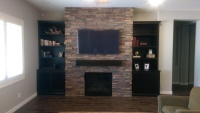 Custom shelving and stone fireplace