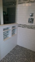 Modern Bathroom Remodel with White Subway Tile and Glass Tile Inlay