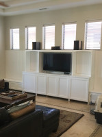 Custom built white entertainment center with Wainscoting.