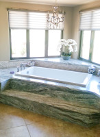 Elegant step up sunken in jacuzzi bathtub install.