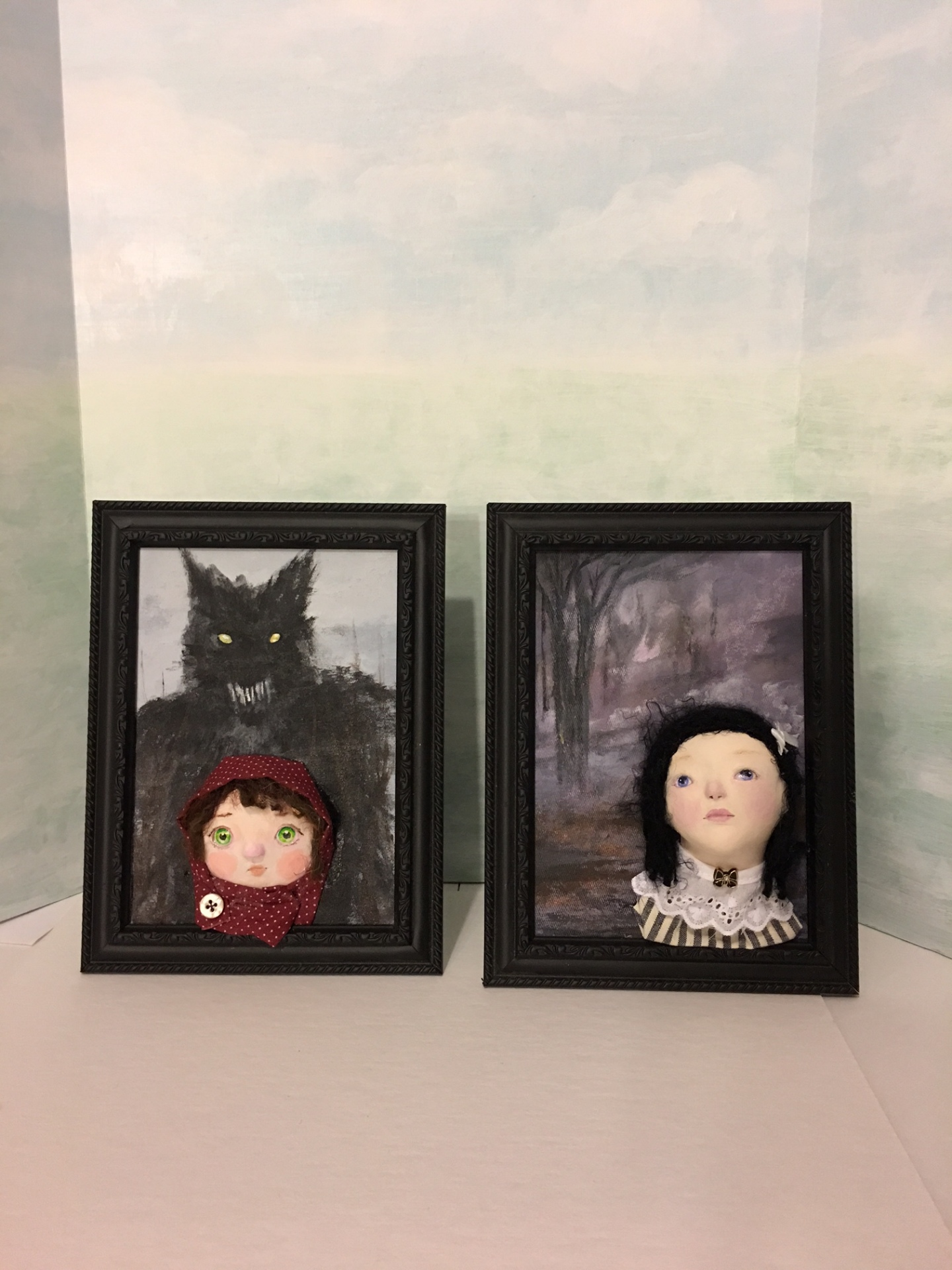 sculpted doll in frame