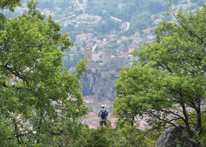 A man enjoying a spectacular view over the city of Foix