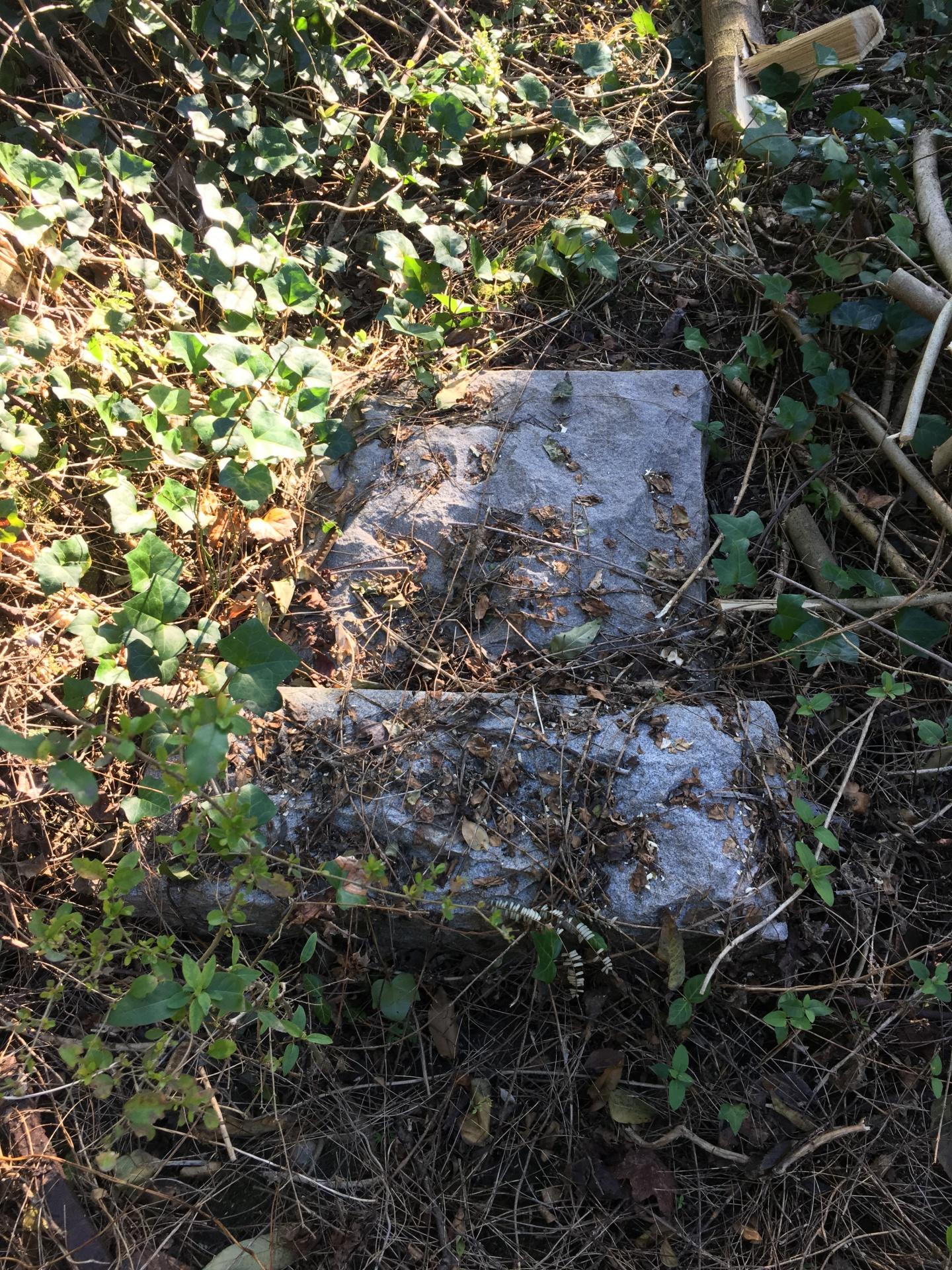 A broken head stone.