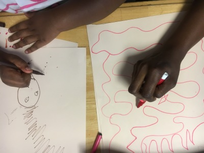 Mother and Child create side by side during drawing from music workshop at Laurel House Women's Shelter