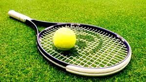 It is a picture of a tennis racket with a tennis ball resting on top of it