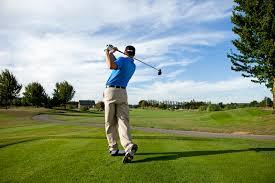 image of a man hitting a golf ball