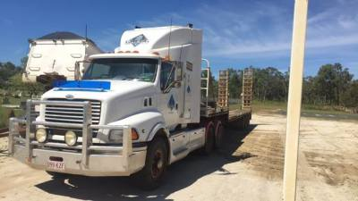 1999 Sterling Prime Mover with Tri-Axle Drop Deck Trailer