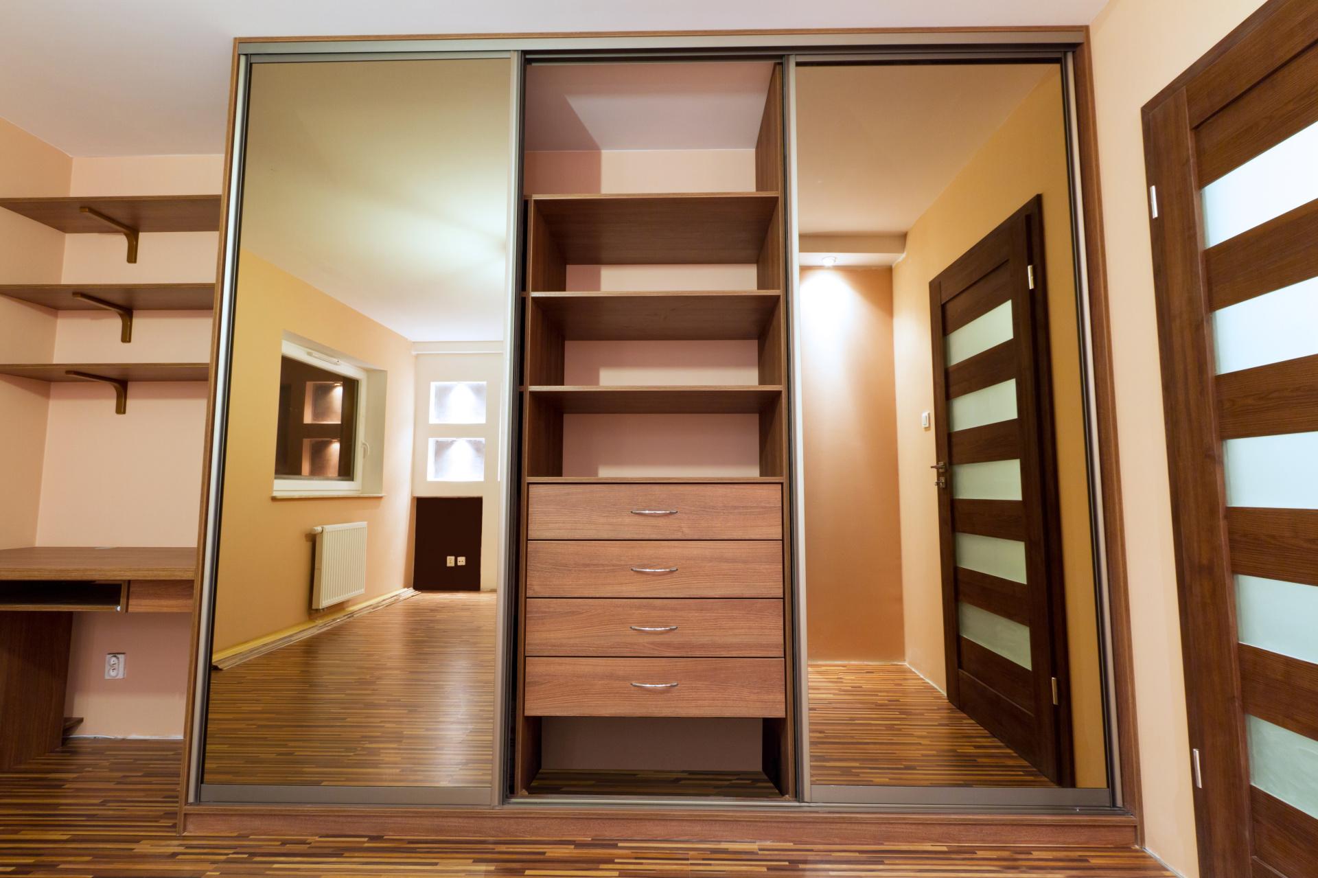 Modern apartment interior with huge sliding wardrobe Landsons.co.uk