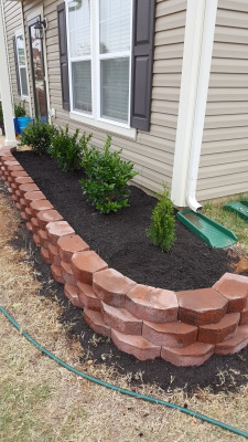 Flower bed retaining wall