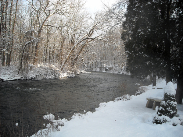 winter scene along rive with snow