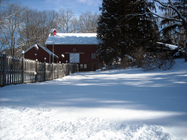 Long view of barn along fence
