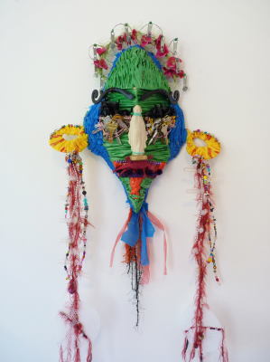 masks made from coat hangers and found objects
