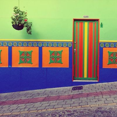 Day 141, Guatapé, you give good door. The decor on each of the houses represents the trade of the family.