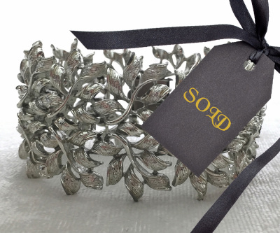 Coro Bracelet with Silver Tone Leaf Design $20